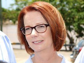 Julia Gillard will sich im Parlament entschuldigen. Das finden nicht alle gut.