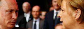 Kanzlerin Merkel und Russlands Präsident Putin sprechen auch über strittige Themen.