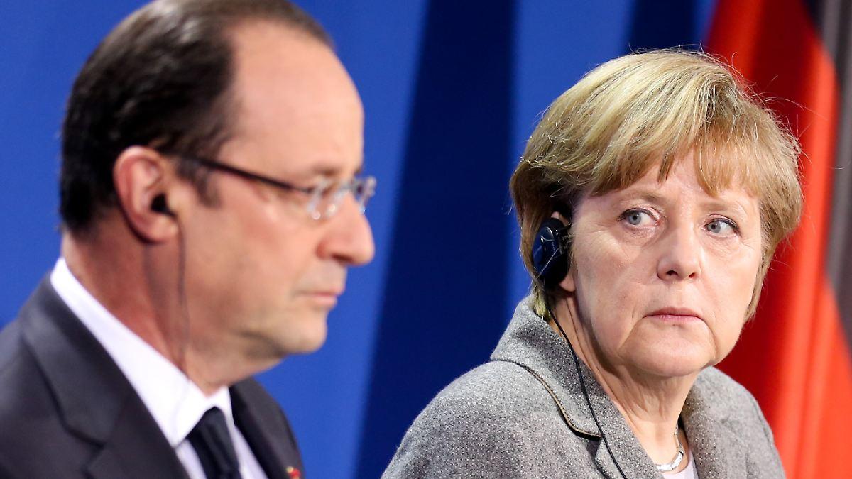 Merkels schwierige Mission in Paris