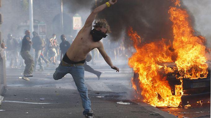 Brennende Autos, vermummte Demonstranten in Rom. Diese Bilder werden nicht die Ausnahme bleiben, fürchtet die ILO.