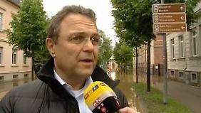 """Innenminister Friedrich in Grimma: """"Hilfskräfte sind in beispielhaftem Kampf"""""""