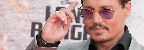 """Zum Scherzen aufgelegt: Johnny Depp bei der Deutschlandpremiere von """"Lone Ranger"""" in Berlin."""