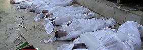 Bilder von Leichenbergen gingen am 21. August um die Welt.