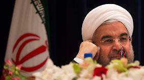 Irans Präsident Ruhani will die Aufhebung internationaler Sanktionen erreichen.
