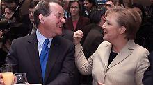Verhandlungspartner, verbunden über eine Hintertreppe: Merkel und Müntefering.