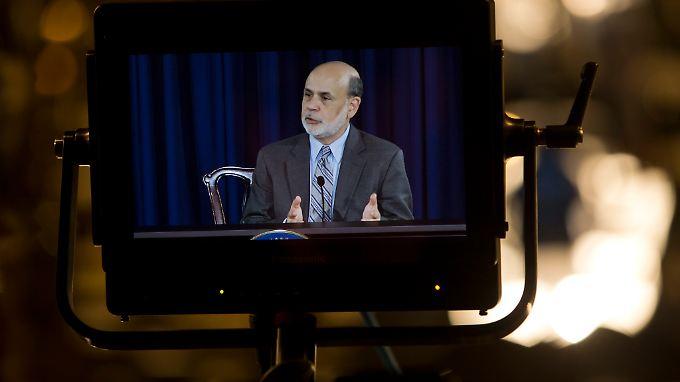 """Bernanke im Fokus: Die US-Wirtschaft wächst """"mäßig bis moderat""""."""