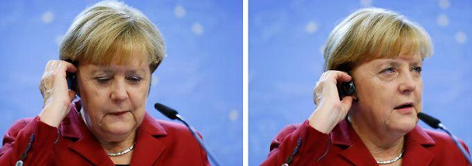 Nach dem EU-Gipfel erklärt Merkel die Handhabung ihrer Telefone.