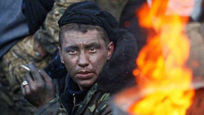 Seit Wochen harren die Demonstranten aus - auch bei klirrender Kälte.