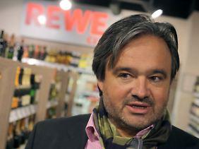 Rewe-Chef Alain Caparros beklagt den Preiswettkampf im Einzelhandel.
