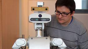 Noch zwei Jahrzehnte könnte es dauern, bis der Roboter ein nützlicher, robuster und selbstverständlicher Helfer im Alltag ist.