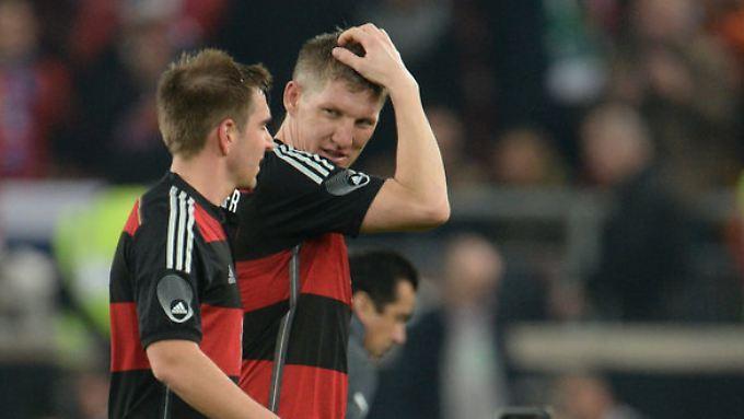 Philipp Lahm (l) und Bastian Schweinsteiger.