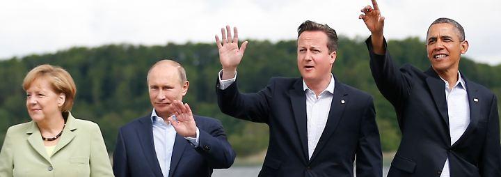 Da war die Welt noch in Ordnung: Angela Merkel mit Wladimir Putin, David Cameron und Barack Obama beim G8-Gipfel im Juni 2013 in Nordirland.