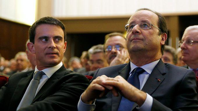 """Frankreichs Premierminister Manuel Valls (links) sagte, dass Präsident Hollande nach der Europawahl Initiativen für eine """"aktive Währungspolitik"""" starten wolle."""