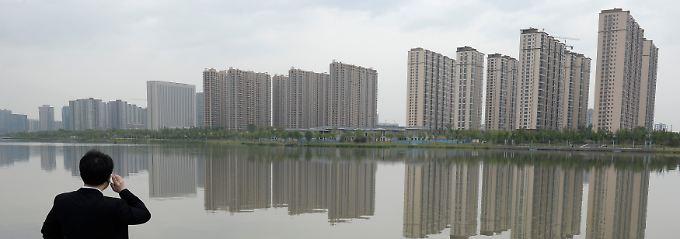 Dramatische Veränderungen, gigantische Ausmaße: Peking weist die Provinzen an, sehr viel mehr Geld in die Infrastruktur und den Wohnungsbau zu lenken.