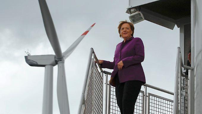 """""""Noch brauchen wir Atom, Gas und Kohle"""": Merkel besucht Windpark"""