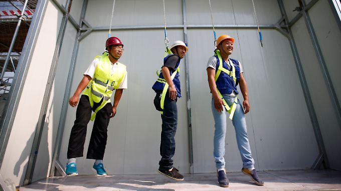 Hängt etwas durch: In den USA (hier Arbeiter beim Sicherheitstraining) entstehen im August überraschend wenig neue Jobs.