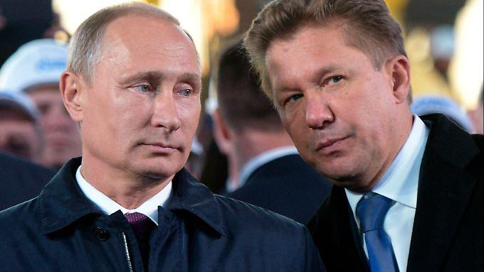 Russlands Präsident Wladimir Putin und Gazprom-Chef Alexei Miller: Der Staatskonzern hat für die Ukrainekrise schon vorgesorgt.