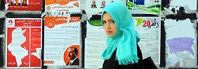 Die Straßen von Tunis hängen voller Wahlplakate.