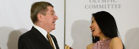International Olympic Committee President Thomas Bach shares a laugh with musician Vanessa-Mae, who will compete for Thailand as alpine skier Vanessa Vanakorn before the IOC President's Gala Dinner on the eve of the opening ceremony of the 2014 Winter Olympics, in Sochi, Russia. The Internatio
