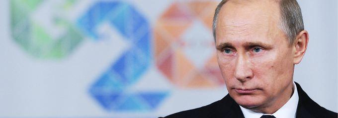 Aus Brisbane reiste Putin vorzeitig ab. Er müsse am Montag wieder arbeiten, sagte er zur Begründung.