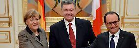 Krisendiplomatie in Kiew: Merkel und Hollande wollen Gewalt stoppen