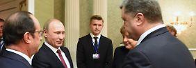 Verhandlungsmarathon in Minsk: Putin und Poroschenko reichen sich die Hand