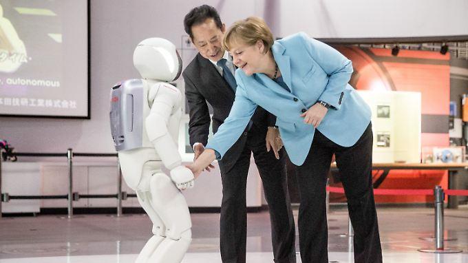 Bundeskanzlerin in Japan: Roboter verweigert Merkel die Hand