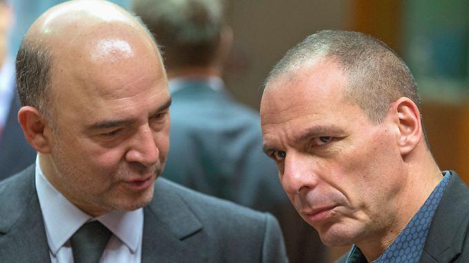 Währungskommissar Pierre Moscovici (l) und Athens Kassenwart Yanis Varoufakis.