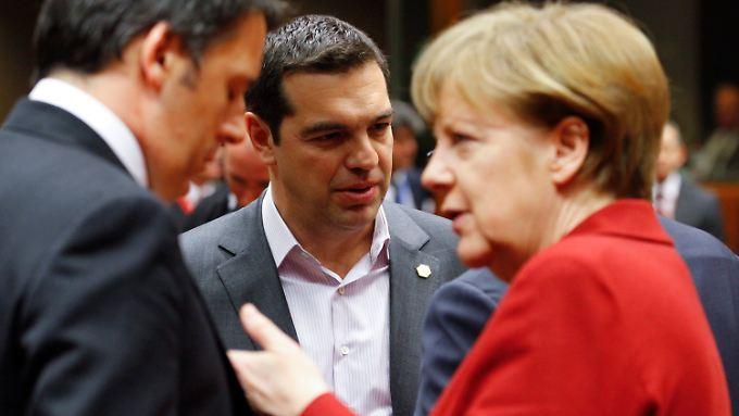 Alexis Tsipras und Angela Merkel beim EU-Gipfel in Brüssel, ihrem ersten Aufeinandertreffen.