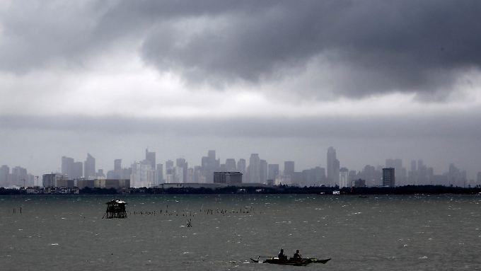 Skyline von Manila. Rund 10 Millionen Filipinos leben und arbeiten Schätzungen zufolge im Ausland.