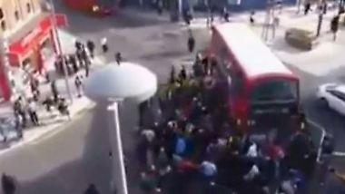 Kollektiver Kraftakt in London: Dutzende Passanten heben Bus an und befreien Einradfahrer