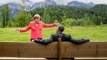 Bild, das um die Welt ging: Was sagte Merkel bloß zu Obama?