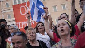 Ja zum Euro, aber bitte ohne Sparen: Ausgang des Griechen-Referendums bleibt spannend