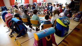Spielen, Lernen, Normalität: Flüchtlingskinder starten in deutschen Schulen