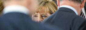 Eine Frage, viele Fronten: Merkels spontaner Krisenbewältigungstag