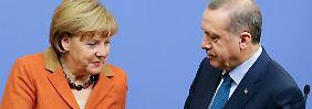 Merkel und Erdogan bei einer gemeinsamen Pressekonferenz Anfang 2013 in Ankara.