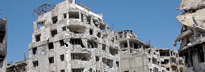 Die Stadt Homs ist von Kämpfen schwer beschädigt.