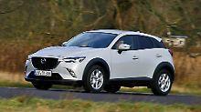 Schwarze Applikationen und Radläufe verschaffen dem Mazda CX-3einen robusten Auftritt.