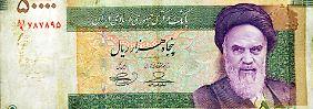 Iranische Rial-Banknote: Nach dem Ende der Sanktionen lockt ein riesiger Markt für westliche Firmen.