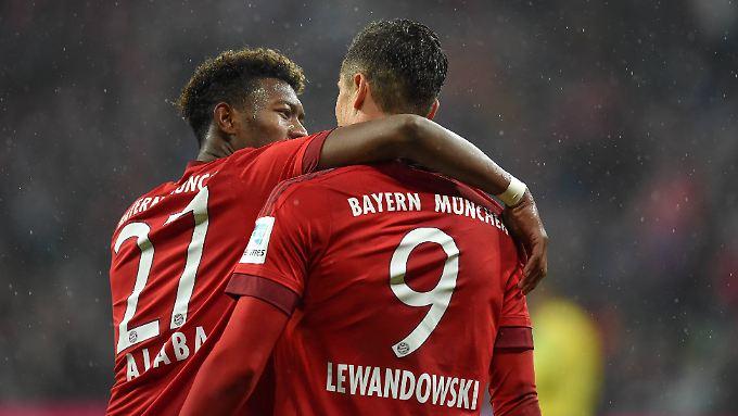 Champions: Die Münchner David Alaba und Robert Lewandowski.