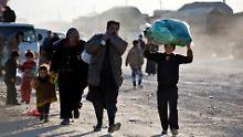 Flüchtlinge an der syrisch-türkischen Grenze.