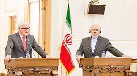 Kommt nach München: Irans Außenminister Mohammed Sarif (r.), hier neben Bundesaußenminister Frank-Walter Steinmeier