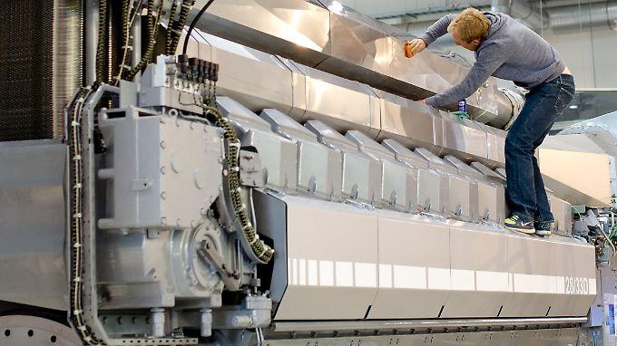 Die Sparte MAN Diesel & Turbo stellt unter anderem Schiffsmotoren her - wie dieses bis zu 13.500 PS starke Modell.