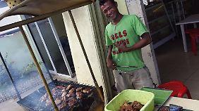 Grillmeister am Straßenrand: An solchen Stränden bekommt man oft großartiges Barbecue.