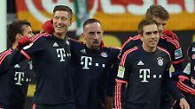 In Wolfsburg am Samstag haben sie schon ein wenig vorgefeiert: Robert Lewandowski, Franck Ribéry, Thomas Müller - und Philipp Lahm.