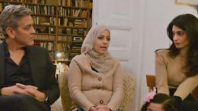 Ermutigende Worte in Berlin: Treffen mit Flüchtlingen bewegt George und Amal Clooney