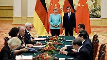 Marktwirtschaft nicht anerkannt: Merkel und Li wollen Handelskrieg abwenden