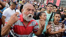 Ein Mann schreit bei einem Hunger-Protest in Caracas, Venezuela.