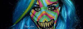 Gesicht und Hand als Leinwand: Künstlerin greift tief in den Farbtopf