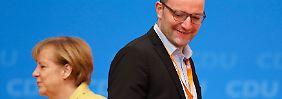 Jens Spahn stellt sich in der Flüchtlingspolitik nicht gegen die Entscheidungen Merkels.